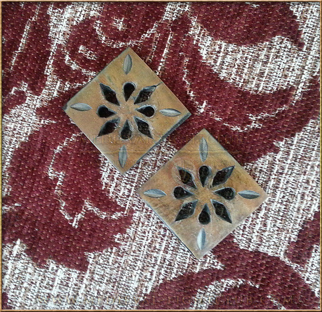 Square hand made horn button with floral pattern